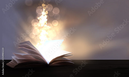 An open book with a magical fantasy. Night view illustration with a book. The magical power of reading and words, knowledge. Abstract background with a book.