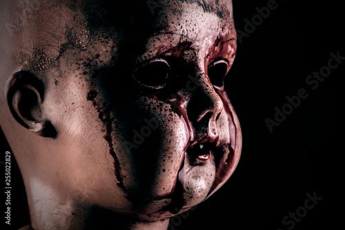 Obraz na płótnie Creepy bloody doll in the dark