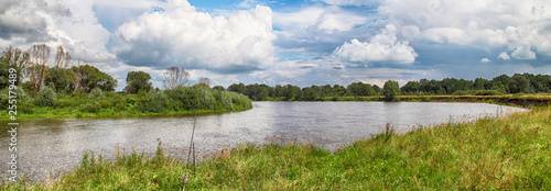 Photo Panorama of the summer landscape with a view of the river and field