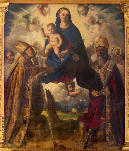 Photo MODENA, ITALY - APRIL 14, 2018: The painting of Madonna with the st