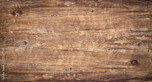 Wood texture background. Rough surface of old knotted table with nature pattern. Top view of vintage wooden timber with cracks. Brown rustic wood for backdrop.