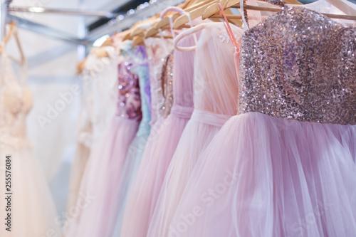 Canvastavla Beautiful elegant evening dresses on hangers in the showroom.