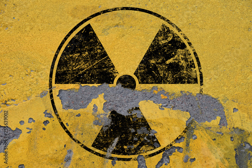 Canvas Print Black radioactive sign over yellow background
