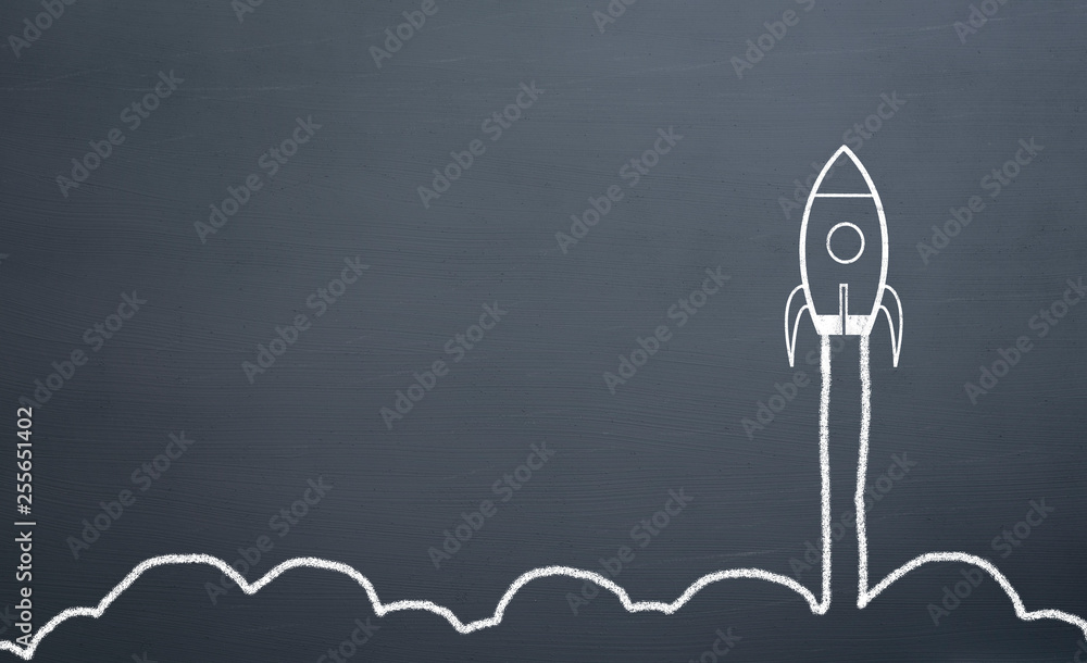 chalk drawing rocket on blackboard Going up quickly
