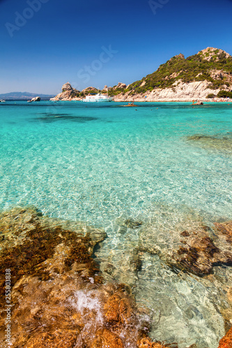 Leinwand Poster Clear turquoise water of Cala Corsara in Sardinia Italy