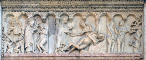 Fotografie, Obraz Creation Of Adam and Eve, Temptation relief by Wiligelmo, Modena Cathedral, Ital