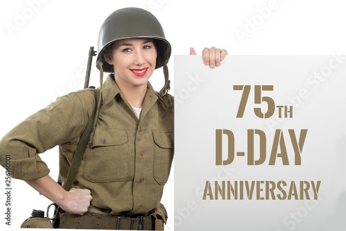 Canvas Print young woman dressed in us  wwii military uniform with helmet sho