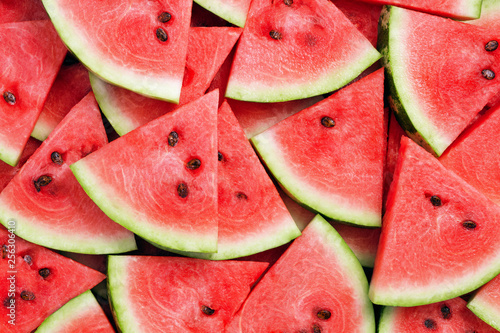 heap of watermelon slices as background