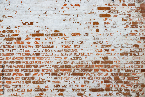 The texture of the old brick wall painted white with peeling paint Fototapeta