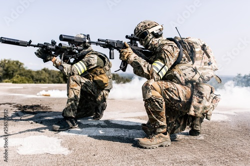 Wallpaper Mural Group of armed man in camouflage with sniper gun in hand