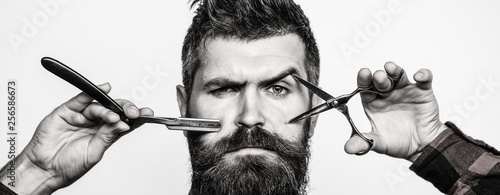 Bearded man, bearded male. Portrait of stylish man beard. Barber scissors and straight razor, barber shop. Vintage barbershop, shaving.