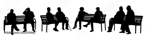 People silhouettes sitting on a bench Fototapeta