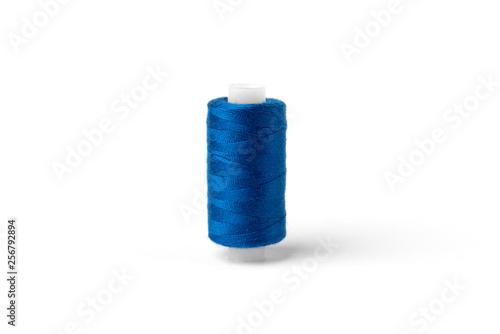 Fototapeta Blue threads isolated on white background.