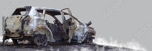 Fototapeta Burnt new car. Isolated on grey background.