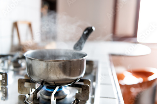 Closeup of vintage tiled gas stove top with tiles white countertop and stainless Fototapeta