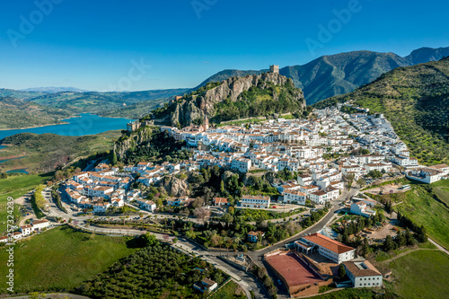 Fotografie, Tablou Zahara de la Sierra aerial view of medieval castle, hilltop village and lake nea