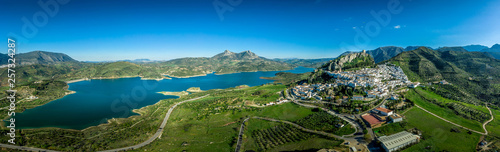 Tela Zahara de la Sierra aerial view of medieval castle, hilltop village and lake nea