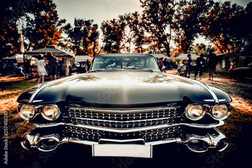 Valokuvatapetti Close-up wide-angled photo of black vintage retro car with shining chrome radiat