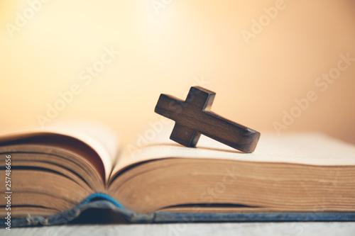 wooden cross on the  book Fototapet