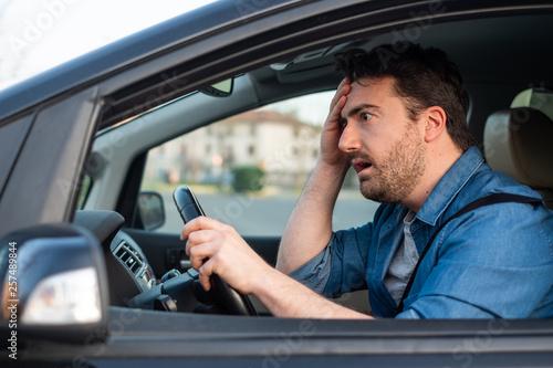 Stampa su Tela Man driving and feeling bad after car crash