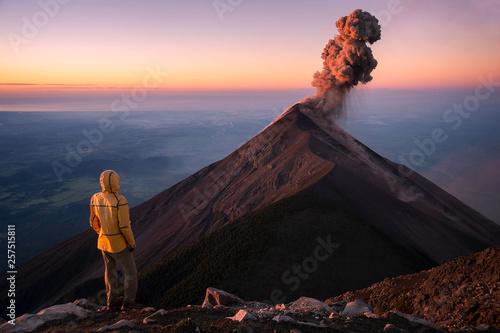 Stampa su Tela Man watching eruption of Fuego Volcano, Guatemala