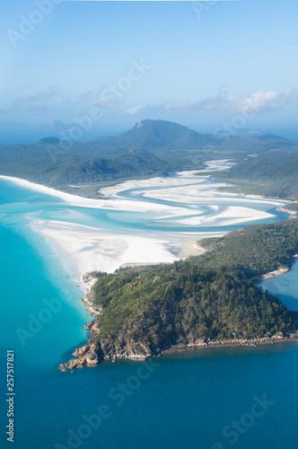 Obraz na płótnie aerial view over whitsunday island beach with blue sunny sky and white sand at w