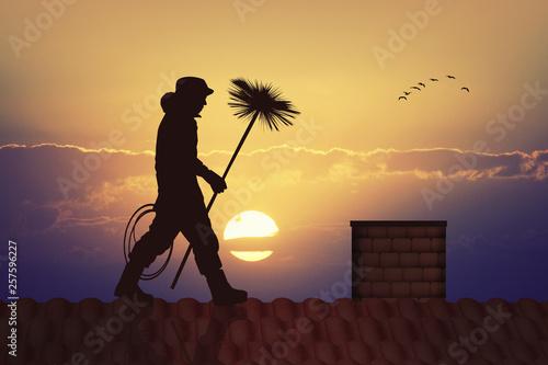Billede på lærred chimney sweep silhouette at sunset