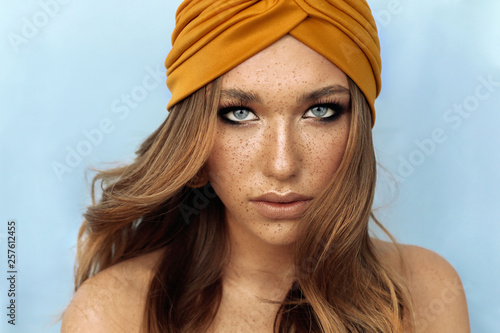 Fotografiet portrait of beautiful young woman with brown hair and freckles face