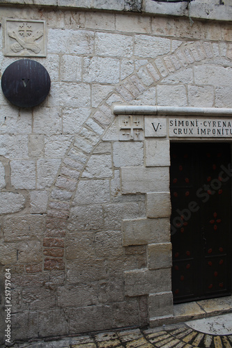 Via Dolorosa, the fifth station, Simon of Cyrene helps Jesus to carry his cross Fototapeta