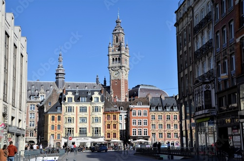 Magnificent belfry in Lille city and baroque facades of Grandplace buildings Fototapete