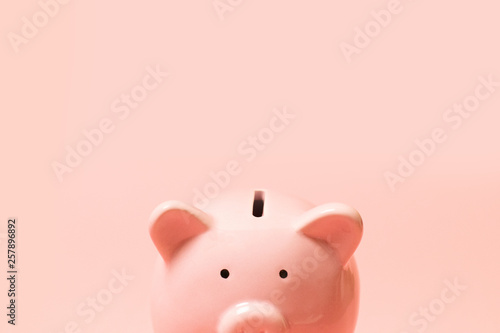Photo pink piggy bank isolated on white background, side view