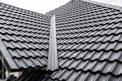 Photo Construction of the roof of the house. Metal tiles.