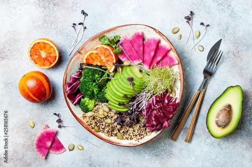 Vegan, detox Buddha bowl with quinoa, micro greens, avocado, blood orange, broccoli, watermelon radish, alfalfa seed sprouts. Top view, flat lay