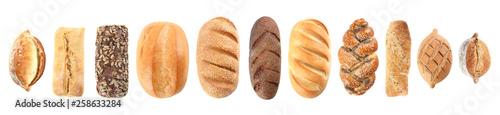 Fotografia Set of fresh bread on white background, top view