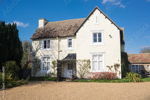 White traditional British country house with bigvgravel yard at the front in England, UK
