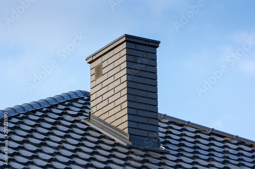 Fotografering roof and chimney