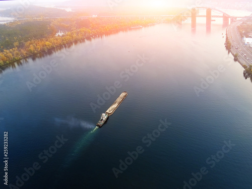 Scenic aerial cityscape of Kiev and river Dnipro at sunset Fotobehang