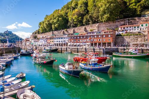 Canvas Fishing port of Donostia-San Sebastián with boats and blue sky