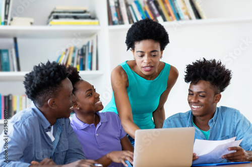 Wallpaper Mural African american female teacher with students