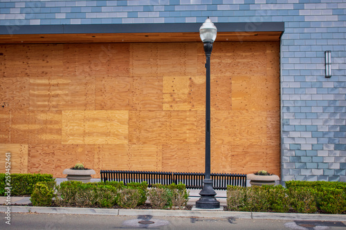 Photo Plywood shutters prevent unauthorized access by squatters, looters or vandals to unused, vacant, or abandoned property