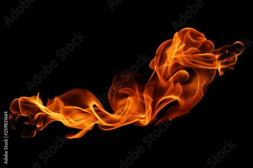 Obraz na plátně movement of fire flames isolated on black background.