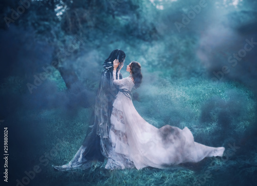 Fotografia brunette girl ghost and spirit of nightly mysterious cold blue forest, lady in w
