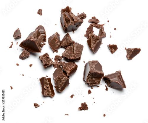 Stampa su Tela Dark organic chocolate pieces isolated on white background