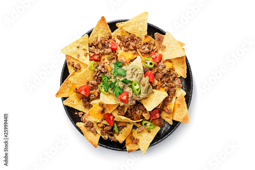 Fotografie, Obraz Corn chips nachos with fried minced meat and guacamole isolated on white background