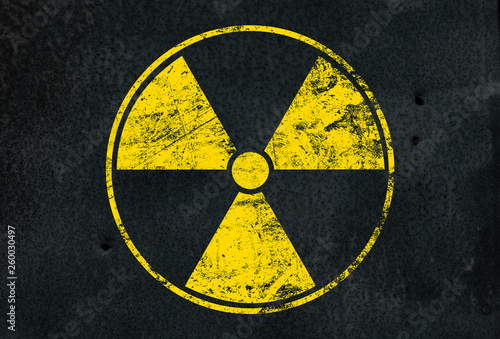 Wallpaper Mural Yellow radioactive sign over black background