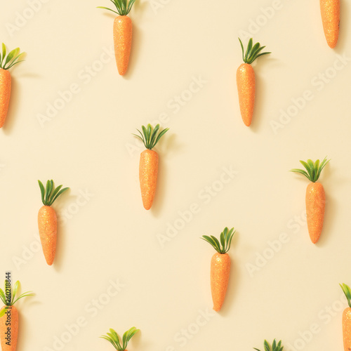 Foto Carrots on pastel yellow background