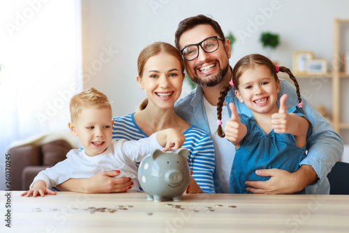 Canvas Print financial planning   family mother father and children with piggy Bank at home