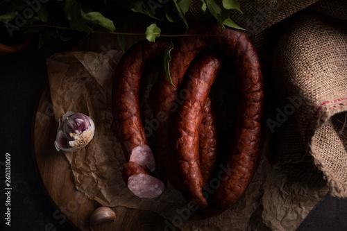 Obraz na płótnie A homemade thin smoked sausage. Traditional natural sausage