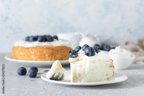 Canvas Print Angel food cake with whipped cream and fresh blueberries.