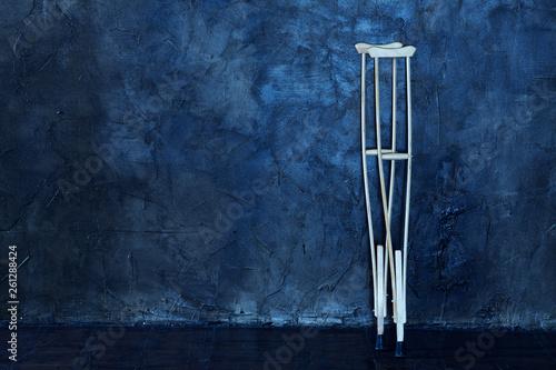 Valokuvatapetti wooden crutches on the  grungy wall.